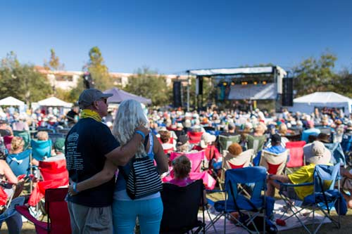 couple standing watching performers at bradenton blues festival